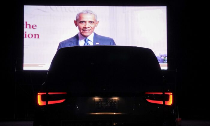 Former President Barack Obama is displayed on a screen as members of the District of Columbia Democratic Party attend a drive-in watch party in the parking lot of the Robert F. Kennedy Memorial Stadium to watch Democratic presidential nominee former Vice President Joe Biden accept the Democratic nomination for president on the final night of the Democratic National Convention in Washington on Aug. 20, 2020. (Drew Angerer/Getty Images)