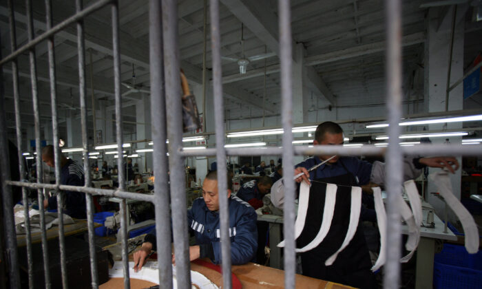 Inmates work in a sewing workshop at a prison in Chongqing Municipality, China, on March 7, 2008. (China Photos/Getty Images)