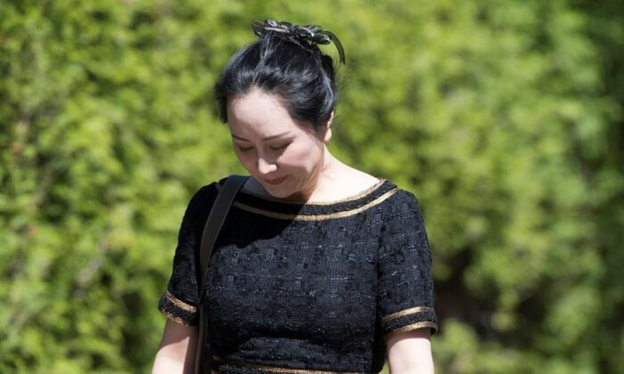 Meng Wanzhou, chief financial officer of Huawei, leaves her home to go to B.C. Supreme Court in Vancouver on May 27, 2020. The legal team for a Huawei executive facing extradition to the United States has lost its battle to have the contents of six confidential documents released to them. Meng Wanzhou's defence team argued in Federal Court that the redacted documents would support its position that Meng suffered an abuse of process during her arrest at Vancouver's airport in 2018. (Jonathan Hayward/The Canadian Press)