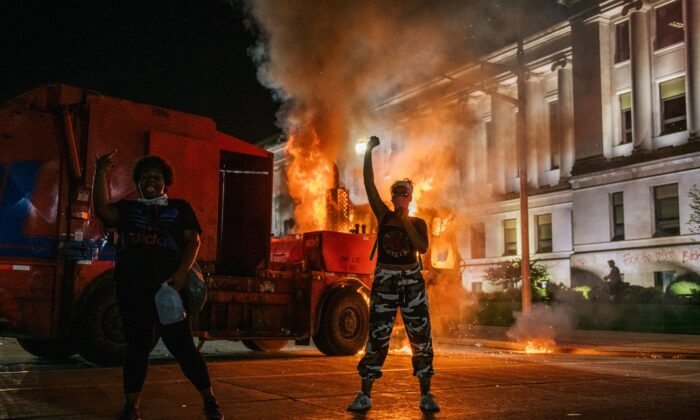 Rioters chant in front of a burning truck in Kenosha, Wis., on Aug. 24, 2020. (Brandon Bell/Getty Images)
