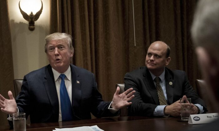 Rep. Tom Reed (R-N.Y.) (R) listens while U.S. President Donald Trump addresses a meeting with lawmakers in the Cabinet Room of the White House on Sept. 13, 2017. (Brendan Smialowski/AFP via Getty Images)