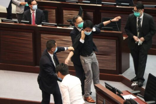 Security officers hold pro-democracy lawmaker Ted Hui