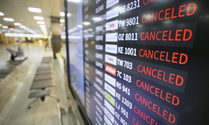 An electronic signboard shows canceled flights at Jeju International Airport on Jeju Island, South Korea, on Aug. 26, 2020. (Byun Ji-chul/Yonhap via AP)