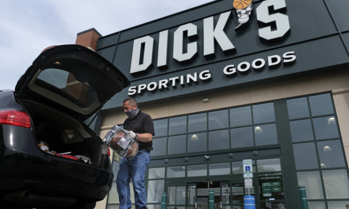 Gus Promollo delivers an order into a customer's trunk at Dick's Sporting Goods in Paramus, N.J., on May 18, 2020. (Seth Wenig/AP Photo)