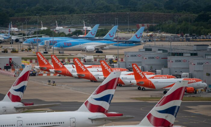 British Airlines, EasyJet and TUI aircraft are pictured at London Gatwick Airport on June 9, 2020. (Chris J Ratcliffe/Getty Images)