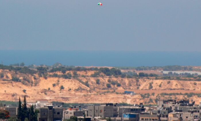 Balloons carrying incendiary devices launched from the Gaza Strip fly over the southern Israeli Kibbutz Nir Am near the border with the Gaza Strip, on Aug. 24, 2020. (Jack Guez/AFP via Getty Images)