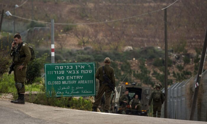 Israeli soldiers stand guard near the border with Lebanon, where the Israeli military are working to destroy alleged Hezbollah tunnels in northern Israel, Israel, on Dec. 4, 2018.  (Amir Levy/Getty Images)
