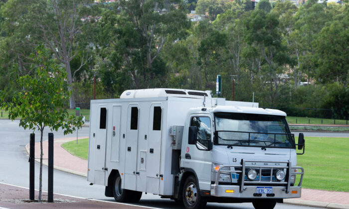 A prison van believed to be transporting former West Coast Eagles AFL player Ben Cousins leaves the Armadale Magistrates Court in Perth on Thursday, April 23, 2020. (Getty image/