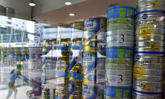 This picture taken on Feb. 16, 2016 shows a shop window displaying tins of baby milk formula in Sydney. (Saeed Khan/Getty Images)