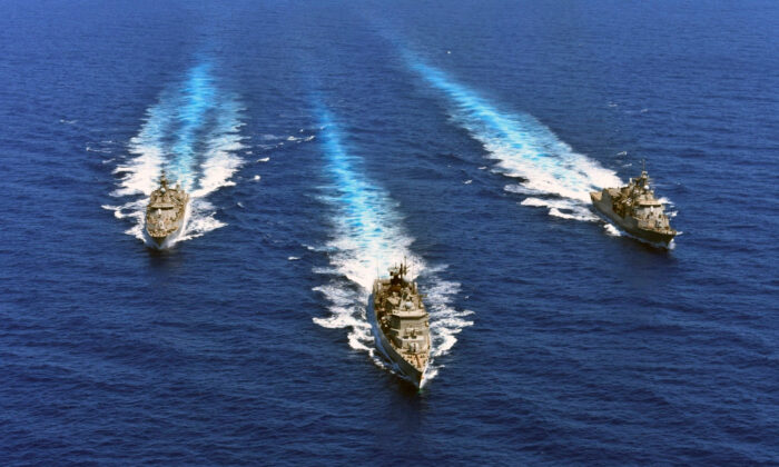 In this photo provided by the Greek Defense Ministry, warships take part in a military exercise in Eastern Mediterranean sea on Aug. 25, 2020. (Greek Defense Ministry via AP)