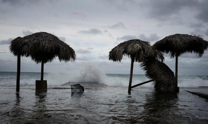 Waves splash during the passage of Tropical Storm Laura in Havana, Cuba, on Aug. 24, 2020. (Alexandre Meneghini/Reuters)