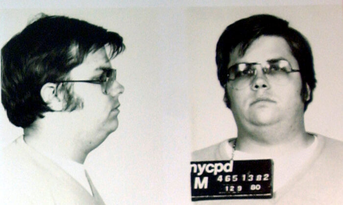 A mug-shot of Mark David Chapman, who shot and killed John Lennon, is displayed on the 25th anniversary of Lennon's death at the NYPD in New York Dec. 8, 2005. Chapman is currently imprisoned at Attica State Prison in New York, serving a 20-year-to-life sentence after pleading guilty to 2nd degree murder. (Chip East/Reuters/File Photo)