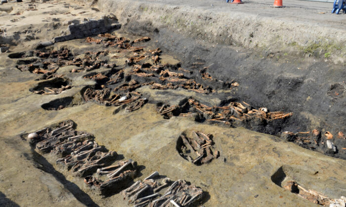 Archaeologists dug up remains of more than 1,500 people, many of them showing signs of death from epidemic, at the site of a 19th century mass grave during excavation ahead of a city development project near a main train station in Osaka, western Japan. (Osaka City Cultural Properties Association via AP)