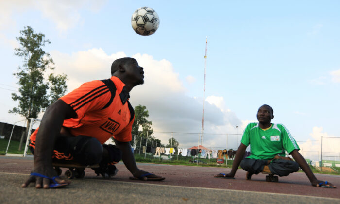 A victim of polio disease heads the ball during a game of para-soccer in Abuja, Nigeria Aug. 22, 2020. (Afolabi Sotunde/Reuters)