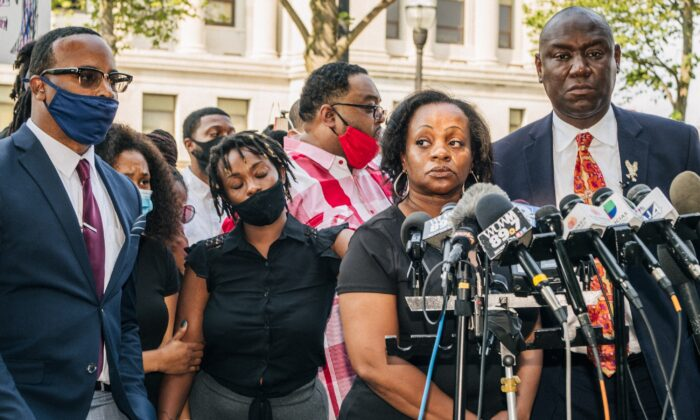Julia Jackson (second from R), the mother of Jacob Blake, prepares to speak during a news conference with attorney Benjamin Crump (R) in Kenosha, Wis., on Aug. 25, 2020. (Brandon Bell/Getty Images)