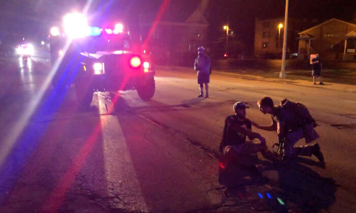 A man is wounded by gunfire amid rioting in Kenosha, Wis., on Aug. 25, 2020. (@Louriealex/Instagram via Reuters)