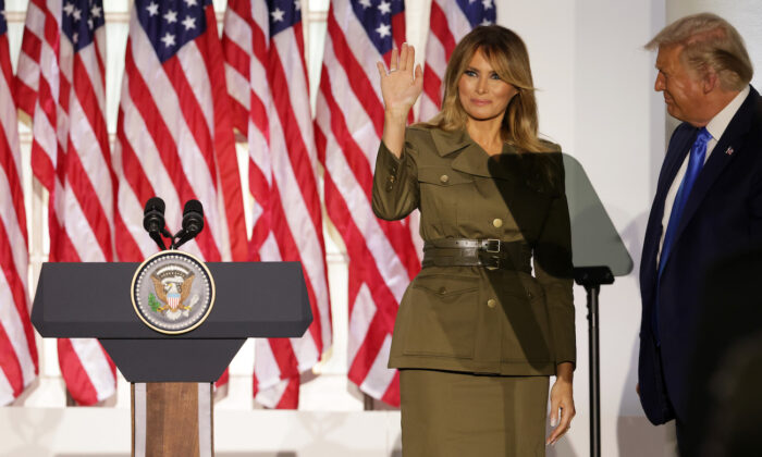 First lady Melania Trump waves as President Donald Trump looks on after her address to the Republican National Convention from the Rose Garden at the White House in Washington, on Aug. 25, 2020. (Alex Wong/Getty Images)