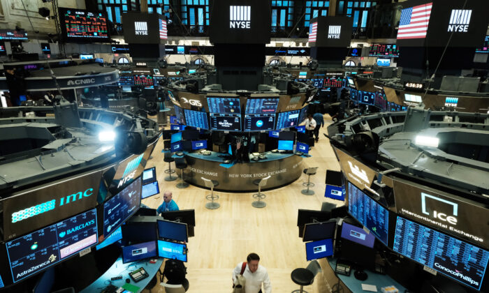 Traders work on the floor of the New York Stock Exchange on March 20, 2020. Since the lockdowns have been lifted, stocks have rapidly recovered their losses from March and the tech titans have been reaching new record highs. (Spencer Platt/Getty Images)