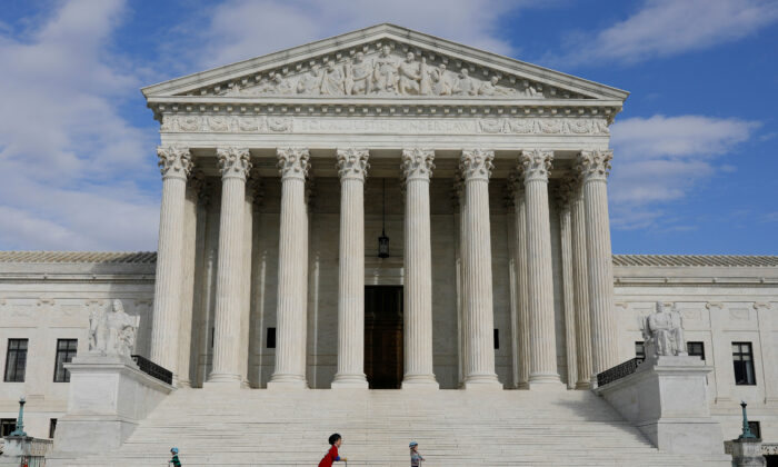 Children ride scooters across the plaza at the United States Supreme Court in Washington, on March 17, 2020. (Tom Brenner/Reuters/File Photo)