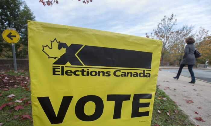 A voting sign at the Fairbanks Interpretation Centre in Dartmouth, N.S., during the federal election on Oct. 21, 2019. Elections Canada is bracing for an increase in the number of Canadians who vote by mail should the country be plunged into an election during the COVID-19 pandemic. (The Canadian Press/Andrew Vaughan)