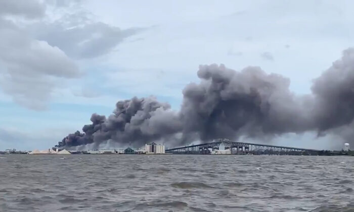 Smoke rises over Lake Charles, La., on Aug. 27, 2020, in this screen grab obtained from a social media video. (Hurricanetrack.com via Reuters)