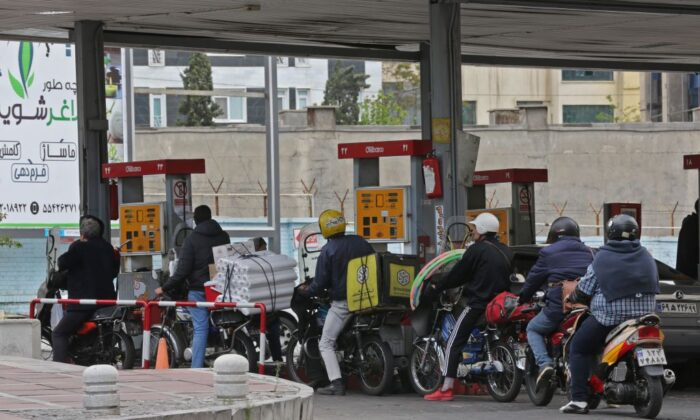 Iranians drivers fill their tanks at a gas station in Tehran, Iran, on April 24, 2019. (Atta Kenare/AFP via Getty Images)