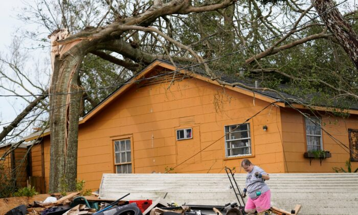 Hollie Moore walks through debris at her home in Lake Charles, La., in the aftermath of Hurricane Laura in Lake Charles, La., on Aug. 27, 2020. (Gerald Herbert/AP Photo)