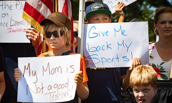 Parents and students gather at a protest supporting a lawsuit calling for the immediate reopening of schools in front of the Orange County Department of Education building in Costa Mesa, Calif., on Aug. 26, 2020. (John Fredricks/The Epoch Times)