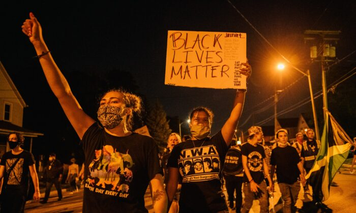 Demonstrators chant in a march in Kenosha, Wis., on Aug. 26, 2020. (Brandon Bell/Getty Images)