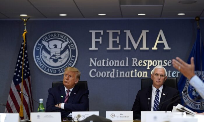 President Donald Trump and Vice President Mike Pence listen during a Hurricane Laura briefing at FEMA headquarters in Washington on Aug. 27, 2020. (Evan Vucci/AP Photo)