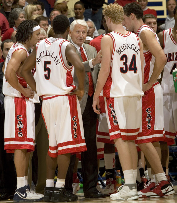 Lute Olson, center, talks to his players during the second half of a college basketball game