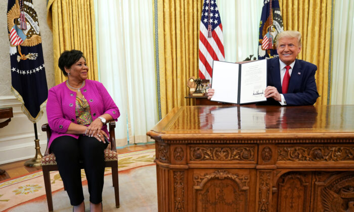 Alice Johnson, who received a life sentence for a first-time drug offense, receives a pardon from President Donald Trump in the Oval Office of the White House in Washington, on Aug. 28, 2020.  (Kevin Lamarque/Reuters)