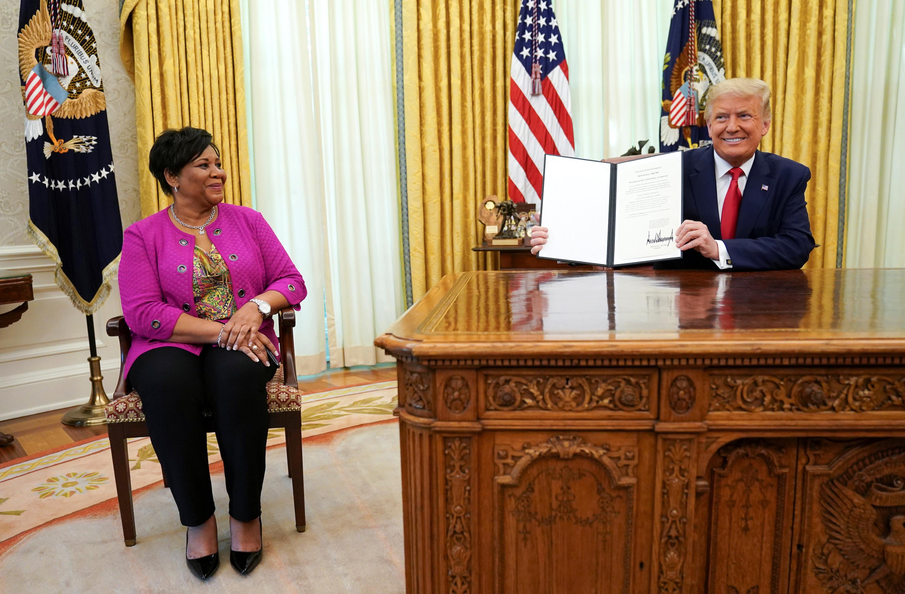 Trump pardons Alice Johnson at the White House in Washington