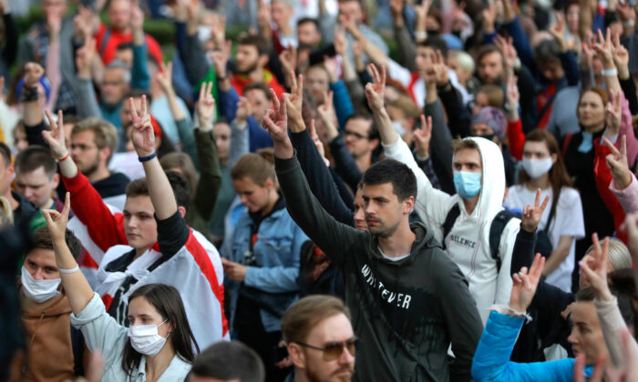 People gesture during a protest at the Independence Square in Minsk on Aug. 27, 2020. (Sergei Grits/AP)