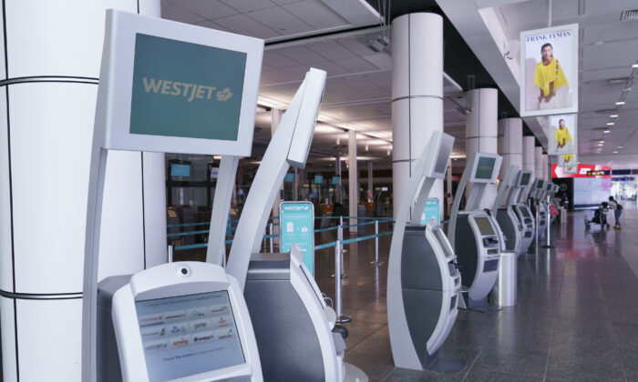 WestJet self-service check-in kiosks are seen at Montreal-Trudeau International Airport on July 31, 2020. (The Canadian Press/Paul Chiasson)