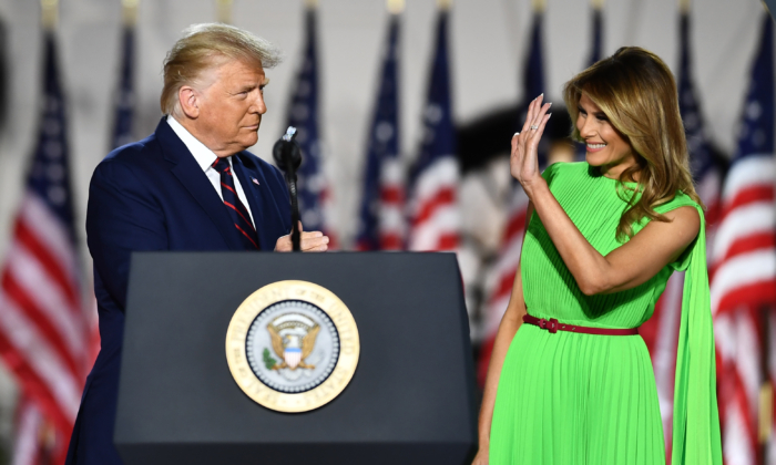 President Donald Trump (L) arrives with wife First Lady Melania Trump to deliver his acceptance speech for the Republican Party nomination for reelection during the final day of the Republican National Convention from the South Lawn of the White House on August 27, 2020 in Washington, DC. (Brendan Smialowski / AFP) (Photo by BRENDAN SMIALOWSKI/AFP via Getty Images)