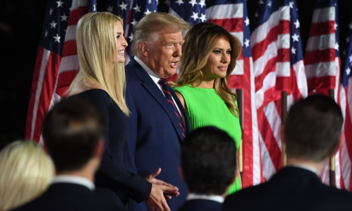 President Donald Trump (C) arrives, flanked by daughter and Advisor Ivanka Trump and wife First Lady Melania Trump, to deliver his acceptance speech for the Republican Party nomination for reelection during the final day of the Republican National Convention from the South Lawn of the White House in Washington, on Aug. 27, 2020. (Saul Loeb/AFP via Getty Images)