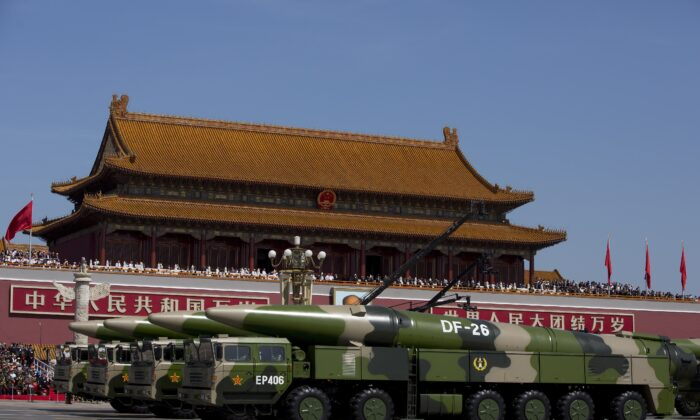 Chinese military vehicles, carrying DF-26 ballistic missiles, drive past Tiananmen Square during a military parade in Beijing, China on Sept. 3, 2015. (Andy Wong - Pool /Getty Images)