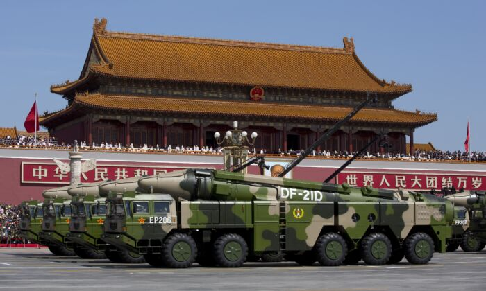 Chinese military vehicles, carrying DF-21D anti-ship ballistic missiles, drive past the Tiananmen Gate during a military parade in Beijing on Sept. 3, 2015. (Andy Wong/Pool/Getty Images)