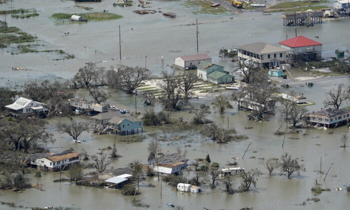 Buildings and homes are flooded in the aftermath of Hurricane Laura on Aug. 27, 2020, near Lake Charles, La. (AP Photo/David J. Phillip)
