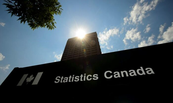 Statistics Canada building and signs are pictured in Ottawa, on July 3, 2019. (The Canadian Press/Sean Kilpatrick)