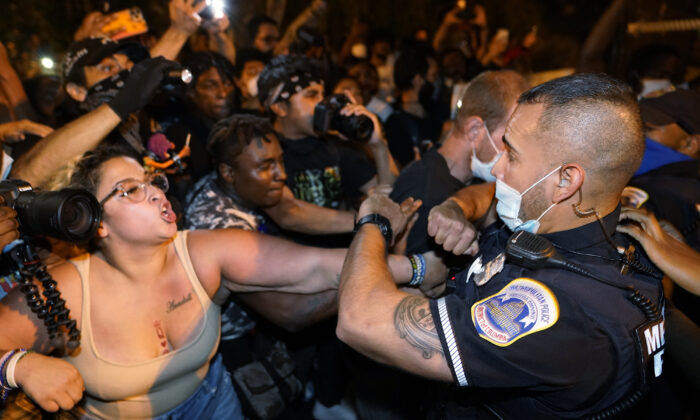 Demonstrators clash with police officers in Washington on Aug. 27, 2020. (Julio Cortez/AP Photo)