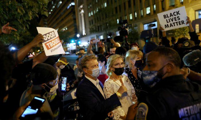 Black Lives Matter demonstrators surround Sen. Rand Paul (R-Ky.) and several women in Washington, early Aug. 28, 2020. (Leah Millis/Reuters)