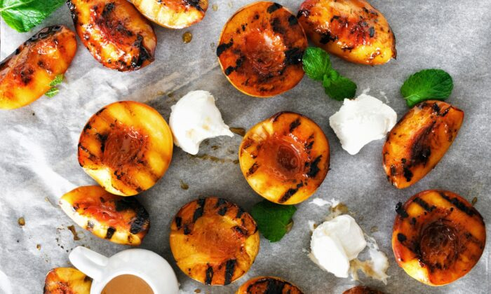 Finish off a late summer meal with grilled peaches, thrown on the last embers of summer. (KucherAV/Shutterstock)
