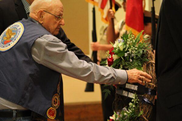 verteran honoring the memory of those fallen during WWII