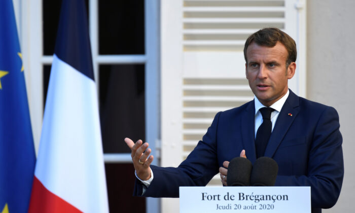 French President Emmanuel Macron speaks at the press conference at in Bormes-les-Mimosas, France on Aug. 20, 2020. (Christophe Simon/Pool via Reuters)