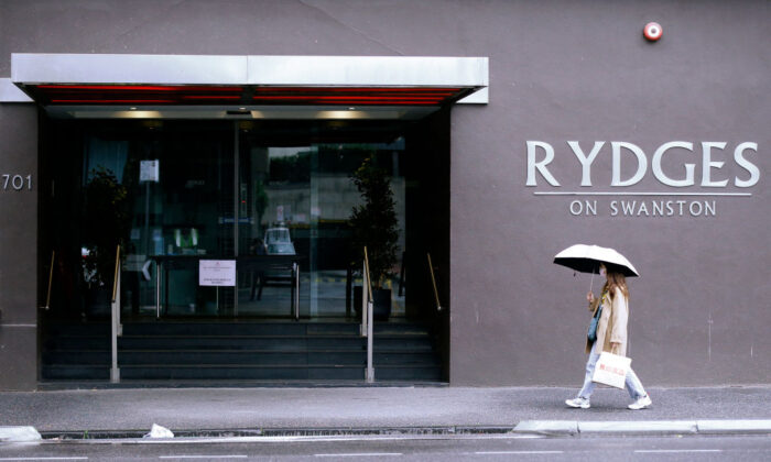 A women wearing a face mask walks past the Rydges Hotel in Carlton in Melbourne, Australia on June 25, 2020. (Darrian Traynor/Getty Images)