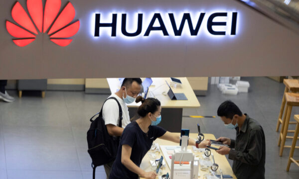 Visitors look at the latest products at a Huawei store in Beijing