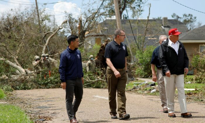 U.S. President Donald Trump accompanied by Department of Homeland Security (DHS) Secretary Chad Wolf and Federal Emergency Management Agency (FEMA) Administrator Pete Gaynor are seen during a visit to areas damaged by Hurricane Laura in Lake Charles, La., Aug. 29, 2020. (Tom Brenner/Reuters)