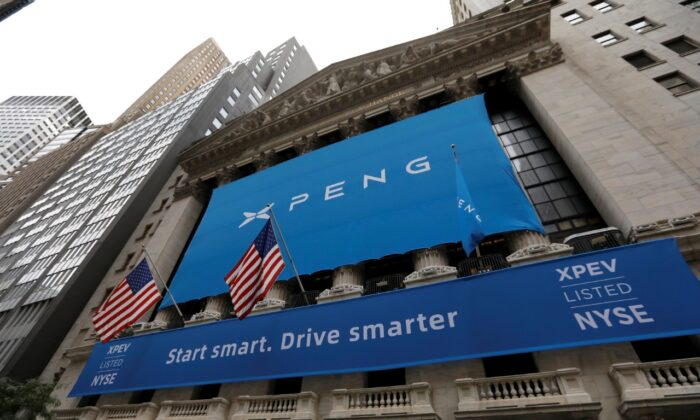 "A banner announcing the Chinese vehicle manufacturer XPeng Inc.  outside the New York Stock Exchange ahead of the company's IPO trading under the stock symbol ""XPEV"" in New York on Aug. 27, 2020. (Reuters/Mike Segar/File Photo)"